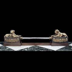An antique steel & brass mastiff dog fireplace fender.