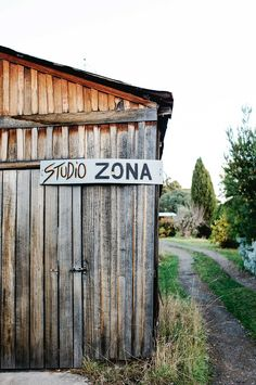 """The two work under the moniker of """"Studio Zona"""". Their studio is a converted garage, containing items like Nanna's wood stove, electric kiln and other amazing bits of pottery machinery Fermentation Crock, Cosy Kitchen, Red Farmhouse, Glass Extension, Visual And Performing Arts, Queenslander, Red Walls, Window Frames, Red Paint"""