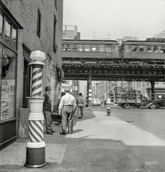 """September 1942. """"New York, New York. Looking north from the Ninth Street station at the Third Avenue elevated railway as a train leaves on the local track."""" Photo by Marjory Collins for the Office of War Information.  Shorpy Historic Picture Archive"""