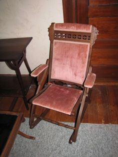 Antique furniture including walnut Eastlake style folding rocking chair with blush colored velvet upholstery