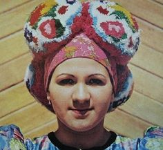 Matyo woman with traditional pom pom headdress - just the thing on a bad hair day