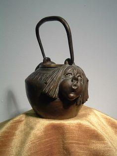 Bronze pot by Gustav Gurschner (1873-1970). Height 15.9 cm (to top of handle).