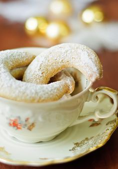 Vanillekipferl are Austrian, German, Czech and Hungarian small, crescent shaped biscuits. They are usually made with ground almonds or hazelnuts. They get their typical flavour from a heavy dusting of vanilla sugar.  Vanillekipferl originate from Vienna in Austria. Traditionally, they are made at Christmas, but they can be enjoyed all year round and are often for sale in Viennese coffee shops.