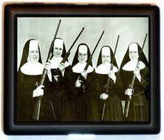 Nuns with Guns Nun Catholic Religious Kitsch Rifles ID or Wallet or Cigarette Case Business Card Holder. $9.99, via Etsy.