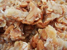 Coconut Cashew Brittle This rich buttery brittle has always been part of our Christmas candy collection. Lots of coconut and cashews ensures its extra scrumptious. - Candy - Ideas of Candy Brittle Recipes, Nut Recipes, Candy Recipes, Sweet Recipes, Holiday Recipes, Snack Recipes, Cooking Recipes, Fudge Recipes, Toffee Brittle Recipe
