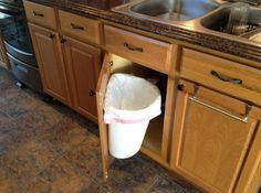rack sack kitchen trash can system in cabinet trash cans | apt