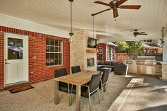 61 Spotted Deer Dr The Woodlands, TX 77381: Photo Expanded covered patio area offers multiple options for outdoor seating and dining.
