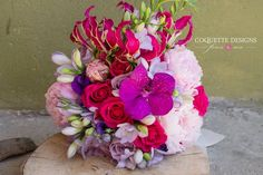 Bright and colorful bouquet, with peonies, roses, freesia, orchid and pink gloriosa - by Coquette Designs