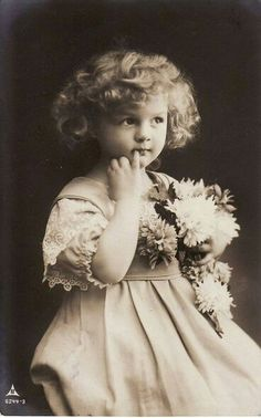 Vintage little girl with flowers / child model studio photo postcard.