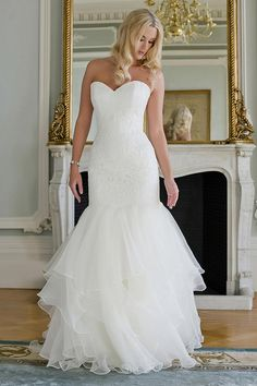 Augusta Jones Bridal dress Style Piper size 12 in Cream. A strapless lace and organza gown with a low back paired with a multi layered fit and flair skirt with train.