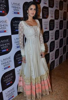 Manish Malhotra. The sleeves have a floral design that looks like polka dots.
