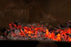 Sparks in a fire Photo about sparks, bonfire, iron, night, darkness, coals, lighting, font, orange, painting, sparkler, screenshot, organ, quail, meat, light, fire, flame - 211926518 Fire Stock, Orange Painting, Quail, Sparklers, Darkness, Iron, Dreams, Stock Photos, Meat