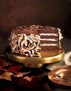 Layers of chocolate cake and coconut cream are covered in dark chocolate frosting for a striking dessert that tastes every bit as good as...