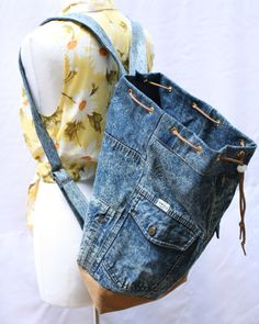 durable, large capacity denim backpack, washable and multipurpose- use it for a long shopping day, as a school bag, a beach bag, a gym bag, or even a nappy bag. handmade from a vintage denim jacket in excellent condition+ tan colored jeans, all cotton * strong adjustable straps, handmade from the same 100% cotton denim * full lining with 1 laptop sleeve (width: 28cm/11) and 1 zipper pocket (width: 20cm/8) height - 47cm/18.5 bottom- 14cm*28cm / 5.5*11 (rectangle) strap length - max…