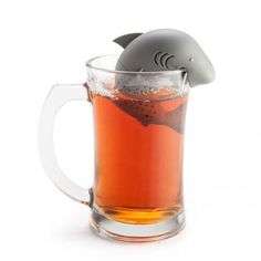 The limited edition Shark Tea Infuser sits with its jaws on your mug and brews your tea. Built from food-safe silicon, this little guy separates into two halves
