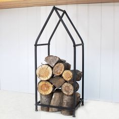Black Metal House Log StoreA great way to store your logs this season is with our black metal house log store. This quirky house shaped design frame is sleek and stylish and is ideal when space is a premium Its stacking design means you can stack up your logs into the metal frame Some basic assembly is required, meaning it can be taken down when not in use. Metal Length: 31.5 Width: 28, Height: 79 cm