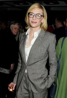 Cate Blanchett looks retro and intellectual wearing horn-rimmed glasses and a tweed gray and black Hermes pantsuit.