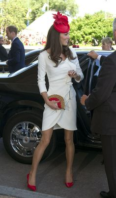 Kate Middleton Beaded Clutch  Kate Middleton accented her chic white dress with a beaded red and gold fan clutch.  Brand: Anya Hindmarch