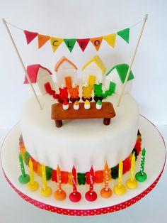 Adorable rainbow gummy cake.