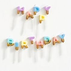 """Make a wish! These amazing happy birthday candles offers the opportunity for an unforgettable birthday moment, and is the perfect special finishing touch for your cake. The pack includes one candle per letter in """"Happy Birthday"""", for a total of 13 candles"""