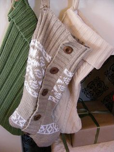 Stockings made from sweaters (thrift store finds).  Turn sweater inside out, trace the pattern, SEW BEFORE CUTTING to avoid unraveling, and cut it all out.