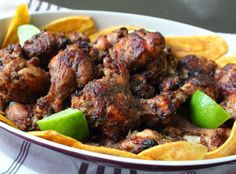 Jerk Chicken Wings – Classic Jamaican Super Bowl Food Recipe Appetizers with chicken wings, yellow onion, garlic, green onions, chili pepper, thyme leaves, kosher salt, black pepper, ground allspice, dried thyme, cinnamon, cumin, grated nutmeg, vegetable oil, soy sauce, brown sugar, fresh lime juice