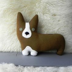 the Corgi  plush wool dog pillow by ThreeBadSeeds on Etsy. Ooooo this little sweet-heart is ready to come to your house. You can just see FUN written all over him & to him; you've got FUN written all over you!!