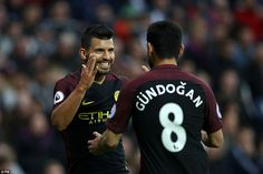 Aguero is congratulated by Ilkay Gundogan after opening the scoring for City at The Hawthorns