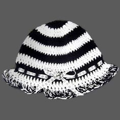 Soccer Hat crochet accessory.  Black and white cotton yarn with soccer ribbon and soccer ball button.  Custom made to order item, so it can be made in any color combination and any size.
