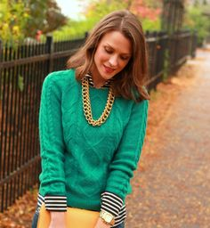 Cableknit sweater and gold necklace