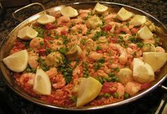 March 26: Spanish Paella Day | Spanish Paella - Mix in your favorite meats or different seafood -- paella to your taste!