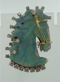 René Lalique.  Carved opal horse head.  Gold harness and diamond mane.  Unique and fancy!