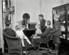 """Washington, D.C., circa 1925. """"Family group listening to radio."""" A baseball game, maybe. The original caption label for this one has been lo..."""