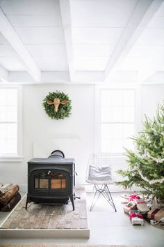 The wood-burning stove heats the house during the colder months Christmas Mantels, Noel Christmas, Christmas Fireplace, Simple Christmas, Inspiration Design, Interior Inspiration, Hearth Pad, Vive Le Vent, Cozy Fireplace