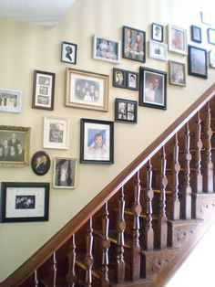 staircase gallery I would like one similar to this but some of the spacing seems off. And more art mixed in.
