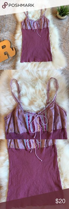 """Free People Tank Top Free People tank top. Size large. Purple ribbed body with a light purple/Floral chest area. The front has pretty light blue, purple, and light pink lace, ribbon, and crocheted detailing. Light purple lace that ties up the front. Very cute and super comfortable! Strap are adjustable and have lace and ribbon detailing. Measures about 27.5"""" from shoulder strap to bottom hem (that can change based on where strap is adjusted) and about 16.5"""" across the chest laying flat…"""