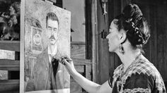 Photograph of Frida Kahlo painting a portrait of her father, by Gisele Greund, 1951.