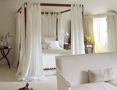 Such a romantic bedroom! love the white canopy