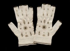 Pair of gloves, England, Great Britain (made), ca. 1795-1825 (made). Knitted cotton embroidered with silk. Victoria and Albert Museum.   [I love these!!]