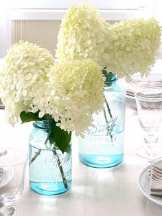 Mason Jar with white hydrangea as centerpieces ... Love it