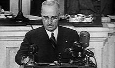 1947, The Truman Doctrine: President Harry Truman gives a speech before Congress on March 12 saying that the US will support Greece and Turkey against Soviet aggression. The Cold War begins.