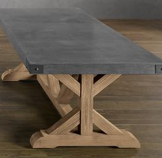 RH's Concrete Rectangular Dining Table:Our eclectic table pairs stout teak beams with an equally sturdy concrete top for a mix of materials that will age beautifully. Aluminum banding encircles the table's apron.