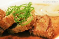 Bistek Lechon Kawali -- double-fried crispy pork belly served with Pinoy classic bistek sauce