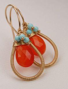 This wire wrapping is meticulous!  The orange and blue really pop against the gold filled wire.  By revelling.etsy.com  #wirewrapping #gemstone #jewelry