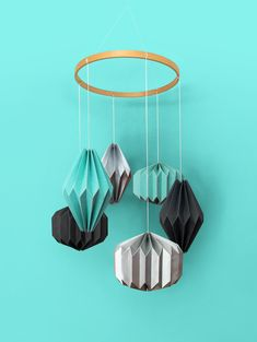 """A stunning hand crafted hanging mobile consisting of six individual geometric shapes folded from specialty stocks. A beautiful wooden """"halo"""" hovers above—complementing the materials below. A unique display worthy of any nursery or child's room. Child's Room, Nursery Room, Nursery Decor, Hanging Mobile, Kidsroom, Geometric Shapes, Baby Shop, Wind Chimes, Babyshower"""