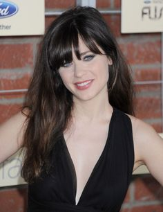 Famous Actress,Singer Zooey Deschanel As Jess From Fox Channel's New Girl Tv Show Wearing Her Beehive 1960's Hairdo.