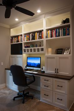Home office built-in desk and cabinets.