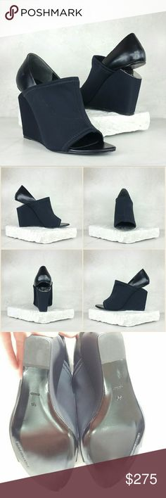 ALEXANDER WANG Alla neoprene and leather wedge Save $275 (50%)  Alexander Wang black Alla sandals. Cutout wedge heel measures approximately 115mm/ 4.5 inches. Neoprene, leather. Open almond toe. Slip on Fits small to size. Size: IT 39 (fits size 8.5)  Brand new. Never worn. Comes with original box and dust bag. Can provide more pictures and info upon request. Reasonable offer only please :) Alexander Wang Shoes Wedges