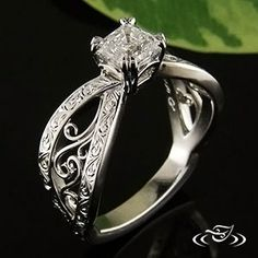 Custom cast platinum mounting with a 1 carat double prong set asscher cut diamond. Pierced bow shaped band with filigree in the large opening and scroll engraving on the band. - See more at: http://www.greenlakejewelry.com/gallery/cust_gallery.aspx?ImageID=84562#sthash.y8oiQ8Md.dpuf