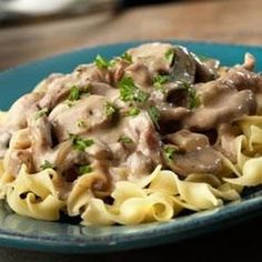 Slow Cooker Creamy Beef Stroganoff With Campbell's Condensed Cream Of Mushroom Soup, Water, Worcestershire Sauce, White Mushrooms, Onions, Garlic, Ground Black Pepper, Boneless Beef Bottom Round Steak, Sour Cream, Egg Noodles, Cooked And Drained, Fresh Parsley
